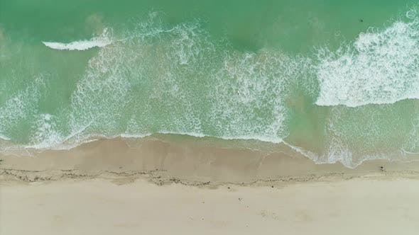 Thumbnail for Sea with Rolling Waves and Sandy Beach. Aerial Vertical Top-Down View
