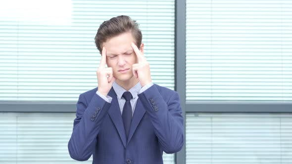 Thumbnail for Headache Gesture by Young Businessman