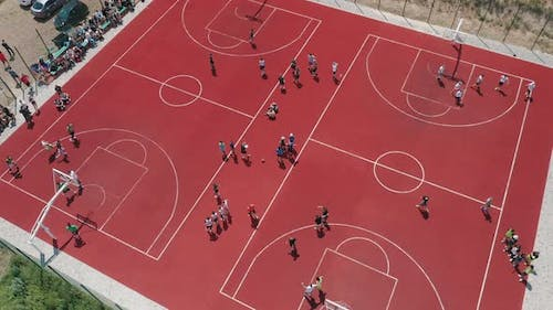 Aerial View of Young Athletes Playing Basketball on an Outdoor Public Basketball Court