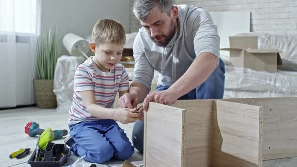 Thumbnail for Father Teaching Son to Assemble Furniture