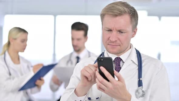 Thumbnail for Portrait of Doctor Using Smartphone at Clinic