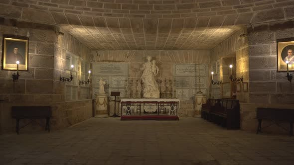 Thumbnail for A tomb and statue in a crypt
