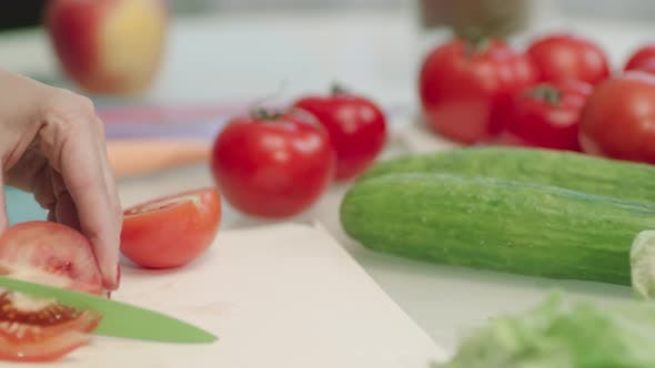Thumbnail for Closeup Female Hands Cutting Red Tomatoes with Knife. Tomatoes on Cutting Board