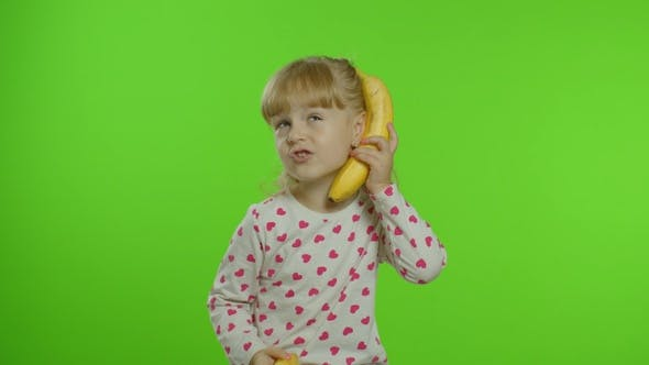 Thumbnail for Happy Child Girl Kid Imitating Telephone Conversation with Banana Isolated on Chroma Key Background