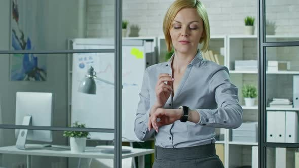Thumbnail for Office Woman Using Smart Watches at Work