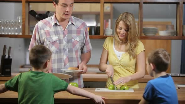Thumbnail for Mother and Father in kitchen prepare snack for kids