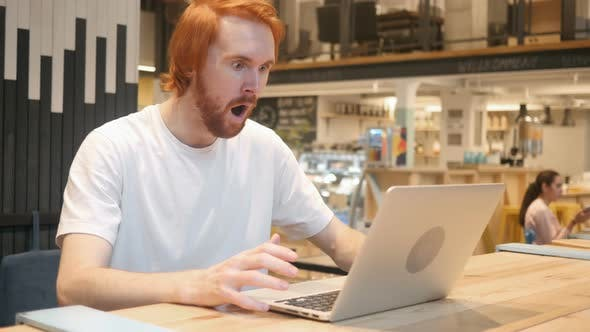 Thumbnail for Shocked, Wondering Redhead Beard Man Working on Laptop