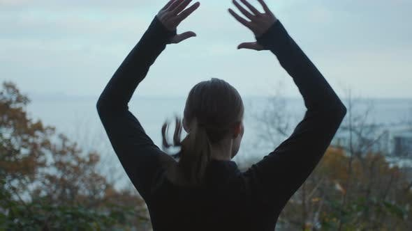 Thumbnail for Woman Performing Star Jumps In Park