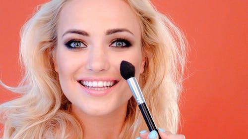 Vivacious Beautiful Woman Applying Cosmetics