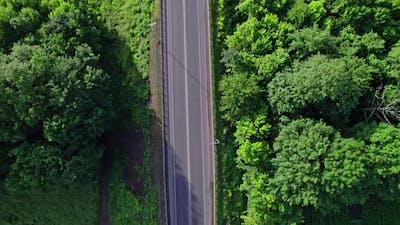 Cars Driving Along Road and Bridge
