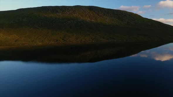 Hill Reflecting in a Lake
