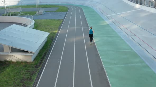 Thumbnail for Aerial View of Plus Size Female Running on Track