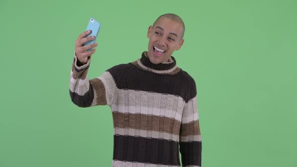 Thumbnail for Happy Bald Multi Ethnic Man Taking Selfie Ready for Winter