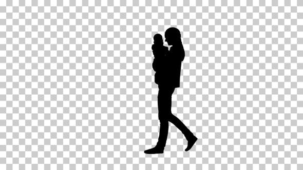 Silhouette mother holding her baby and walking, Alpha Channel