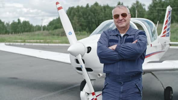 Cover Image for Mature Pilot Proud of his Plane