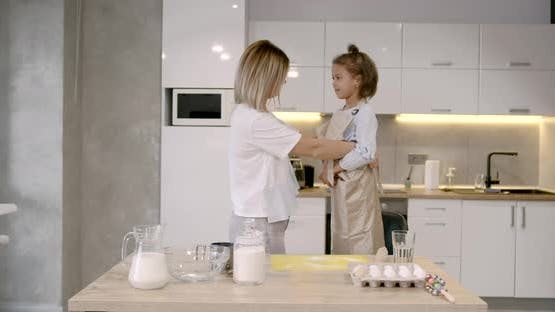 Mother and Daughter Having Fun While Making Dough on Kitchen