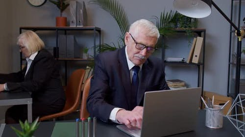 Elderly Man Boss Working in Modern Office Room Interior Senior Freelancer Developing New Project