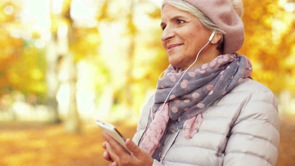 Thumbnail for Old Woman with Smartphone and Earphones in Autumn 18