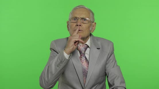 Thumbnail for Elderly Businessman Showing Silence Gesture. Senior Man Showing Shh Gesture