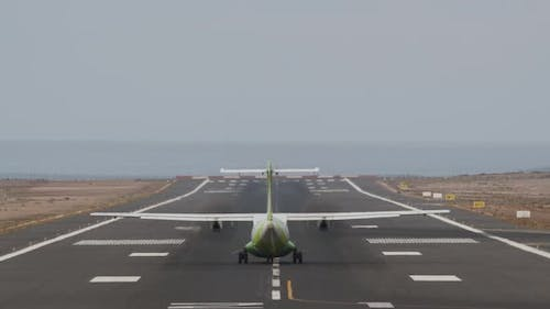 Aircraft Taking Off From Runway By the Ocean
