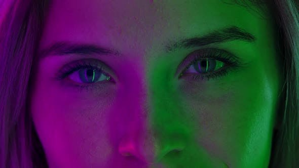 Womens Face Neat Natural Makeup Illuminated Colorful Neon Light Look Straight Ahead
