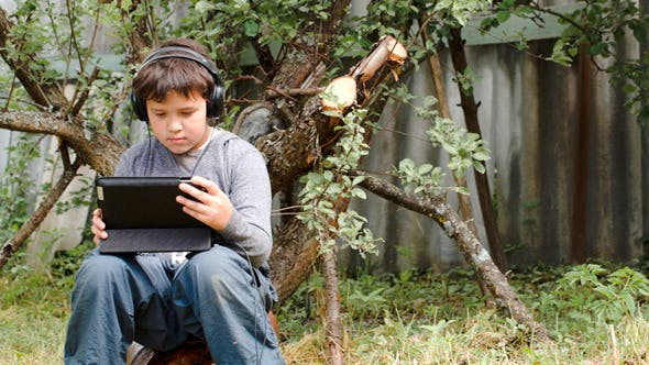 Thumbnail for Teenager In Earphones Using Touchpad Outdoor
