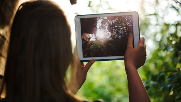 Thumbnail for Woman Taking Pictures Of Nature With A Tablet