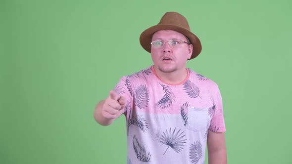 Thumbnail for Happy Overweight Bearded Tourist Man Pointing Finger and Looking Surprised