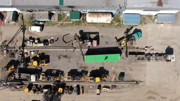Thumbnail for Top View of Cranes Moving Shipping Container on Industrial Site. Aerial View of Loading or Unloading