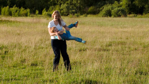 Thumbnail for Young Mother Playing With Her Son Outdoor