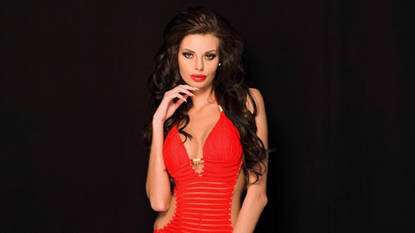 Thumbnail for Gorgeous Sexy Brunette In A Red Costume