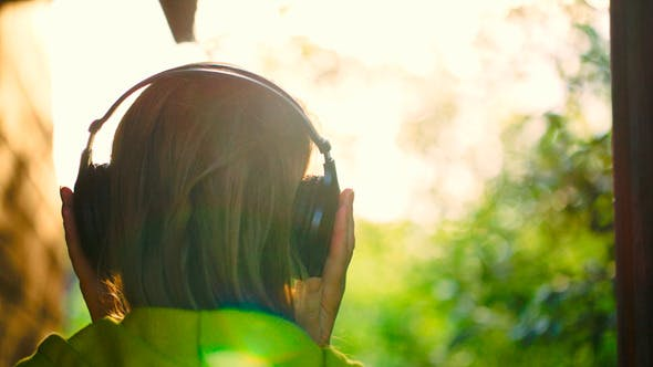 Thumbnail for Girl Listening To Music In Headphones Outdoor