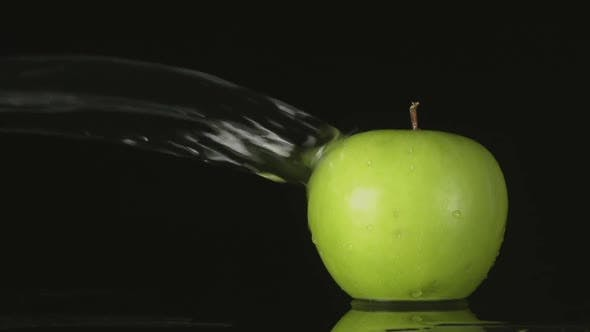 Thumbnail for Water Flow Falls On A Green Apple On A Black Background