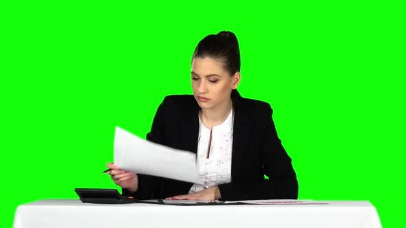 Cover Image for Business Woman Working From Office with Documents. Green Screen