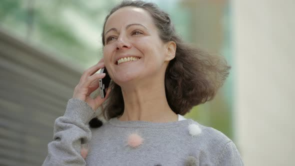Thumbnail for Happy Middle Aged Woman Talking on Phone.