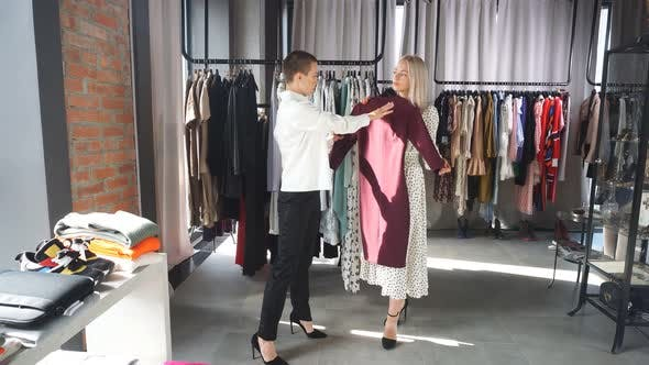 Clothes Designer Show Her Handmade Clothes To Customer
