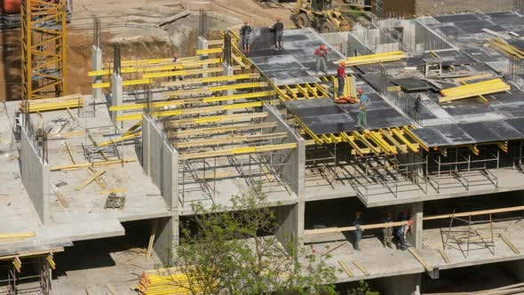 Thumbnail for Builders Seen From Above Working on Construction Site, Workers Laid Floor Slabs Before Concrete