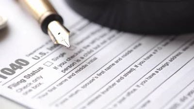 Close Up of a Tax Return Form and Pen on Table