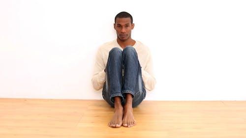 Anxious Man Sitting On The Floor