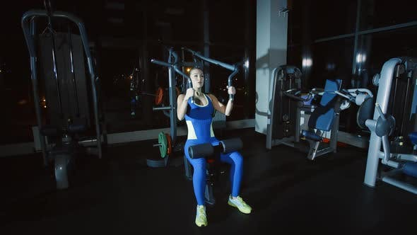 Thumbnail for Woman Workout Training Hands and Shoulders on Weights Lifting Exercise Machine