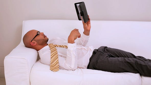 Thumbnail for Tired Businessman Falling Asleep On Couch