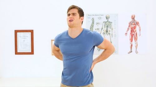 Patient Stretching His Back In Physiotherapy