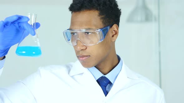 Thumbnail for Scientist, Doctor Looking at Solution in Flask in Laboratory