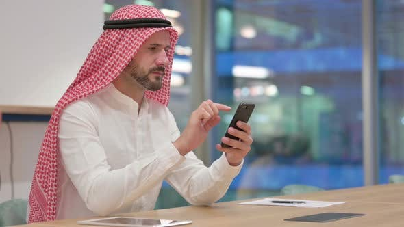 Thumbnail for Arab Businessman Using Smartphone at Work