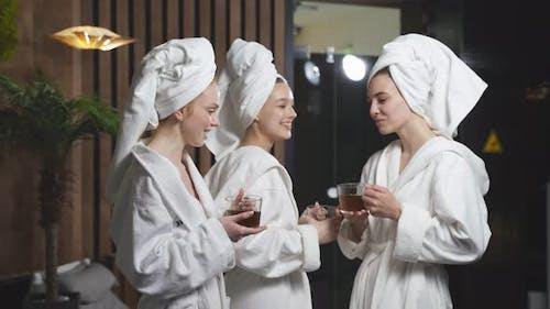 Lady Friends Drinking Herbal Tea After Spa Treatment Having Rest Enjoying Beauty Procedures