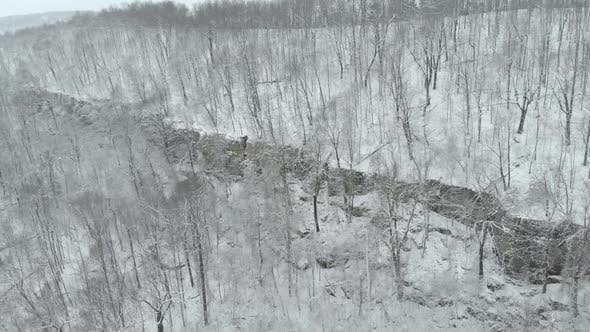 Thumbnail for Aerial of Mountain Bluff In Winter With Snow