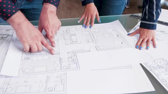 Thumbnail for Close Up of Archtect Pointing at Building Drawing on Blueprint