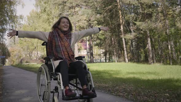 Thumbnail for Cheerful disabled woman in the wheelchair