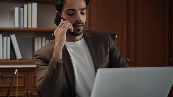 Business man consulting with smartphone