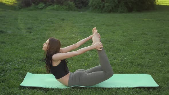 Thumbnail for Woman Practicing Yoga Outdoors in Park